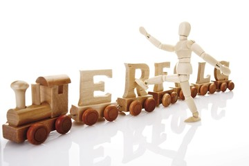 Erfolg, German for success, written with wooden letters on a wooden train