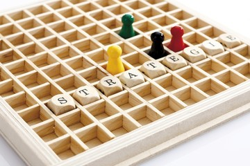 Strategie, German for strategy, written with wooden letters