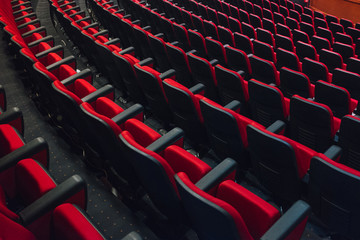 Empty Red Seats in Auditorium