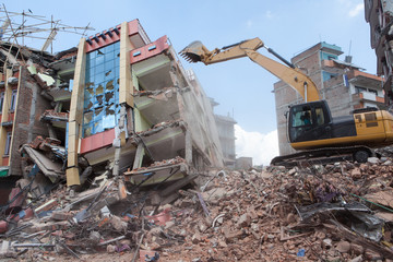 An excavator clearing off debris.