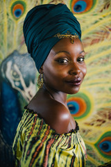 Beautiful african hippie portrait in yellow dress and blue turban