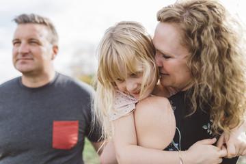 Mother hugging happy child