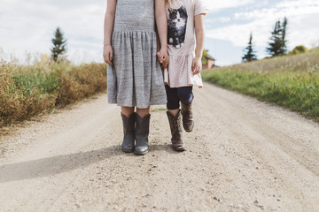 Young sisters wearing cowboy boots