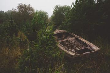 an empty wooden boat ashore