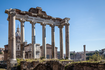 ruins of Temple of Saturn at Roman Forum with blue sky