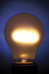 Glowing lightbulb, blue background