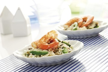 Rice dishes with shrimp, pea pods, long-grain rice and wild rice