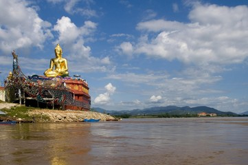 Buddha statue on the side of a river, Mae Salong, Thailand, Southeast Asia, Asia