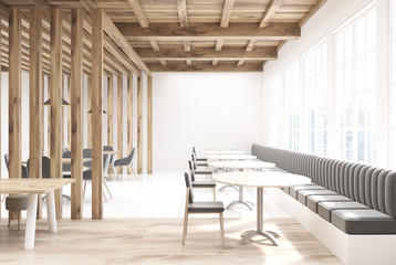 Wooden cafe with gray sofas