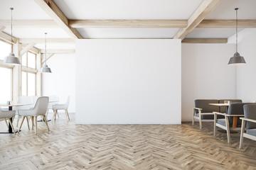White cafe interior, gray sofas
