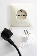 Electrical outlet and black and white plugs