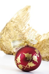 Red Christmas tree bauble with angel's wings