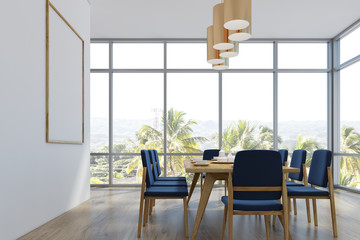 Dining room with a poster, palms, side