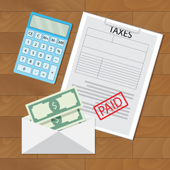 Paid taxes and money in envelope