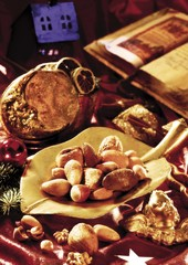 Mixed nuts on a golden plate, christmas atmosphere