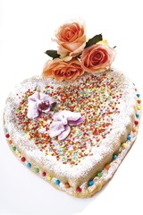 Heart shaped cake covered with marzipan, adorned with roses
