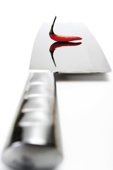 A red chili on a knife blade