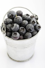 Small tin pail filled with blueberries