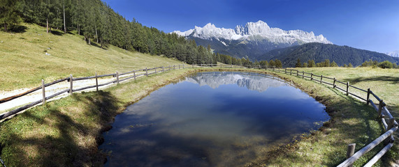 Reflection of the Catinaccio (Rosengarten) massif near Tiers, South Tyrol, Italy, Europe