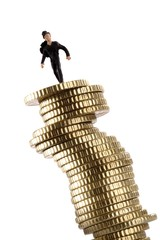 Chimney sweep figure placed on top of a stack of coins