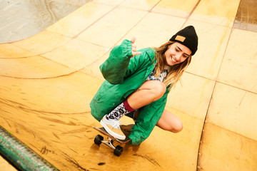 A girl doing skateboarding on a ramp on a rainy weather