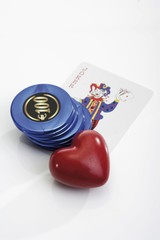Heart, casino chips and joker playing card