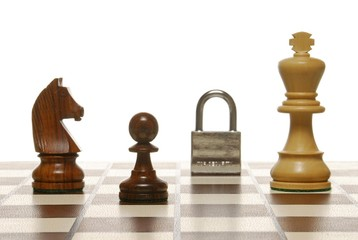 Chess pieces on a chess board with padlock, symbolic of security and strategy