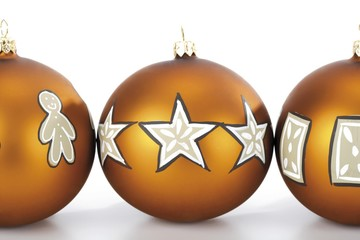 Three golden Christmas ornaments, balls next to each other