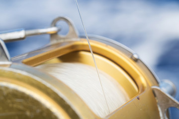 Close up fishing reel and line