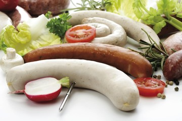 Skewered raw bratwursts, various kinds