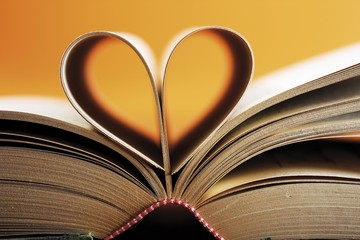 Opened book, pages shaped to form a heart