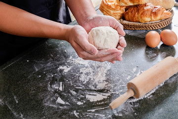 Hands working with dough preparation recipe bread