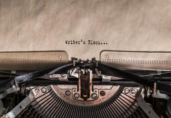 Writer's Block words typed on a Vintage Typewriter. Mechanisms closeup. Typing on old typewriter