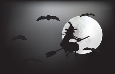 Witch flying on a broom on a full moon