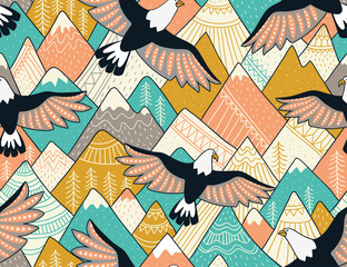 Ethnic seamless pattern with with mountains and eagles. Bright ornamental vector background for fabric, wrap paper and wallpaper.