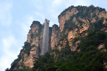 """The elevator on a (mountain) rock. Or probably a """"sky lift"""". It can be found around Wulingyuan scenic area"""