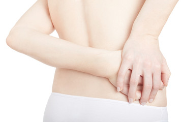 Young woman holding hands on painful area, backache isolated on white, clipping path