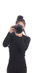 Woman photographer takes images with dslr camera in studio on white background. Asian woman use camera.