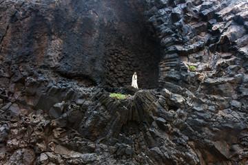 Praying Madonna on a cliff