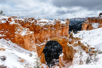 Natural Arch formation with snow in Bryce Canyon.