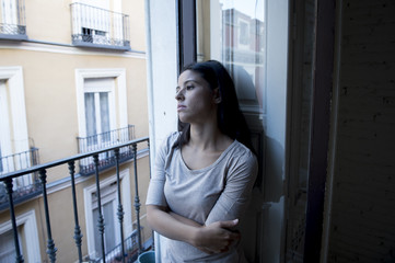 desperate Latin woman at home balcony looking destroyed and depressed suffering depression