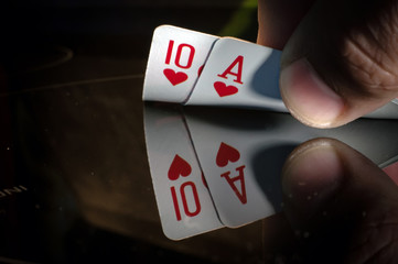 a ten and an ACE of spade in the hands