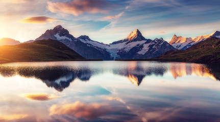 Panoramic view of the Mt. Schreckhorn and Wetterhorn. Location Bachalpsee in Swiss alps, Grindelwald valley, Europe.
