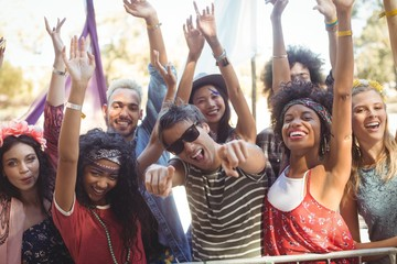 Portrait of cheerful friends enjoying during music festival