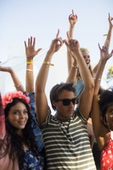 Young friends dancing during music festival