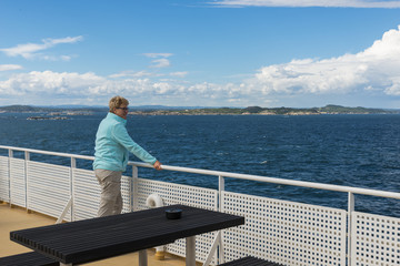 adult woman in blue sweater on ferry