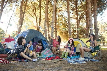 Young friends enjoying together at campsite