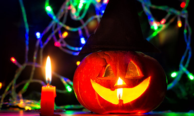 spooky halloween pumpkin with candles and shiny eye