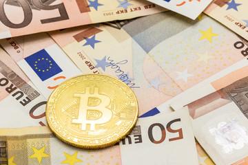 Golden Bitcoin on 50 Euro. Electronic money exchange concept, business concept.