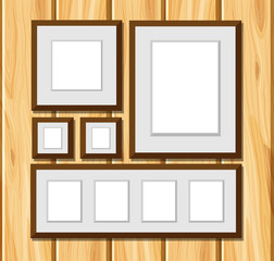 Square frames on wooden wall